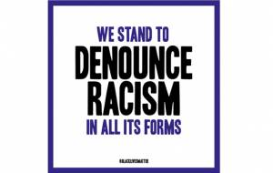 We stand to denounce racism in all its forms.